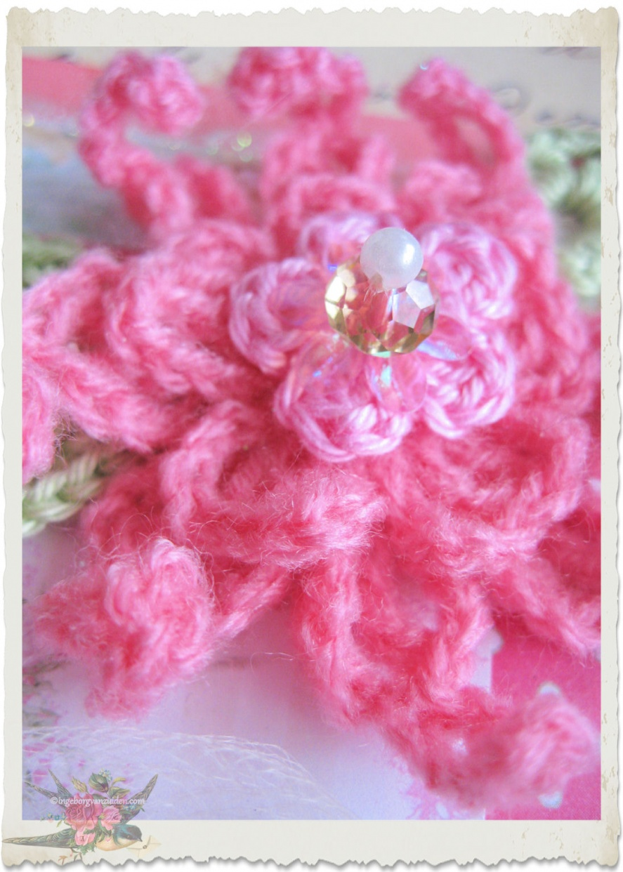 pink wool crochet flower by Ingeborg van Zuiden