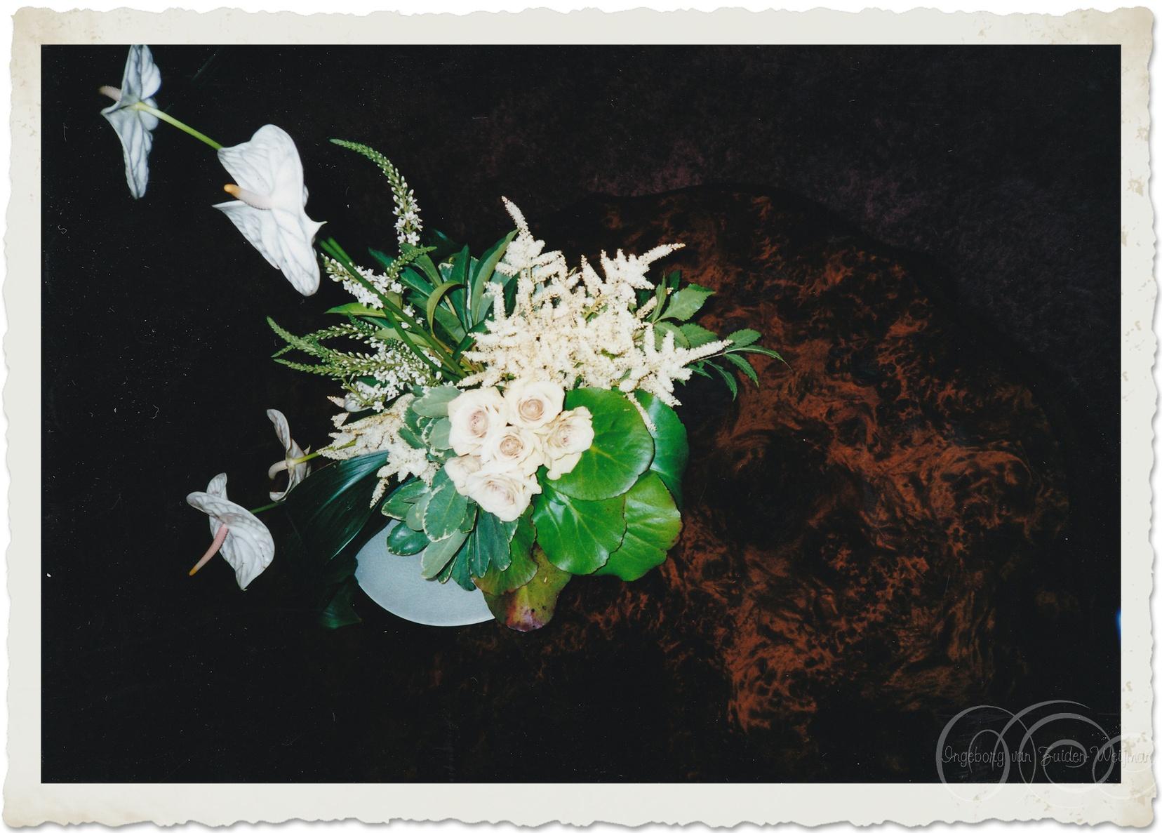 Flower arrangement by Ingeborg van Zuiden with white roses, Anthurrium, Spirea, Astilbe and Bergenia leaves