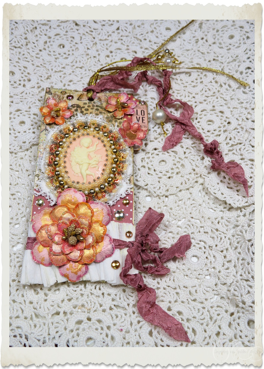 Handmade mixed media tag with angel cameo, beads and paper flowers by Ingeborg van Zuiden Weijman