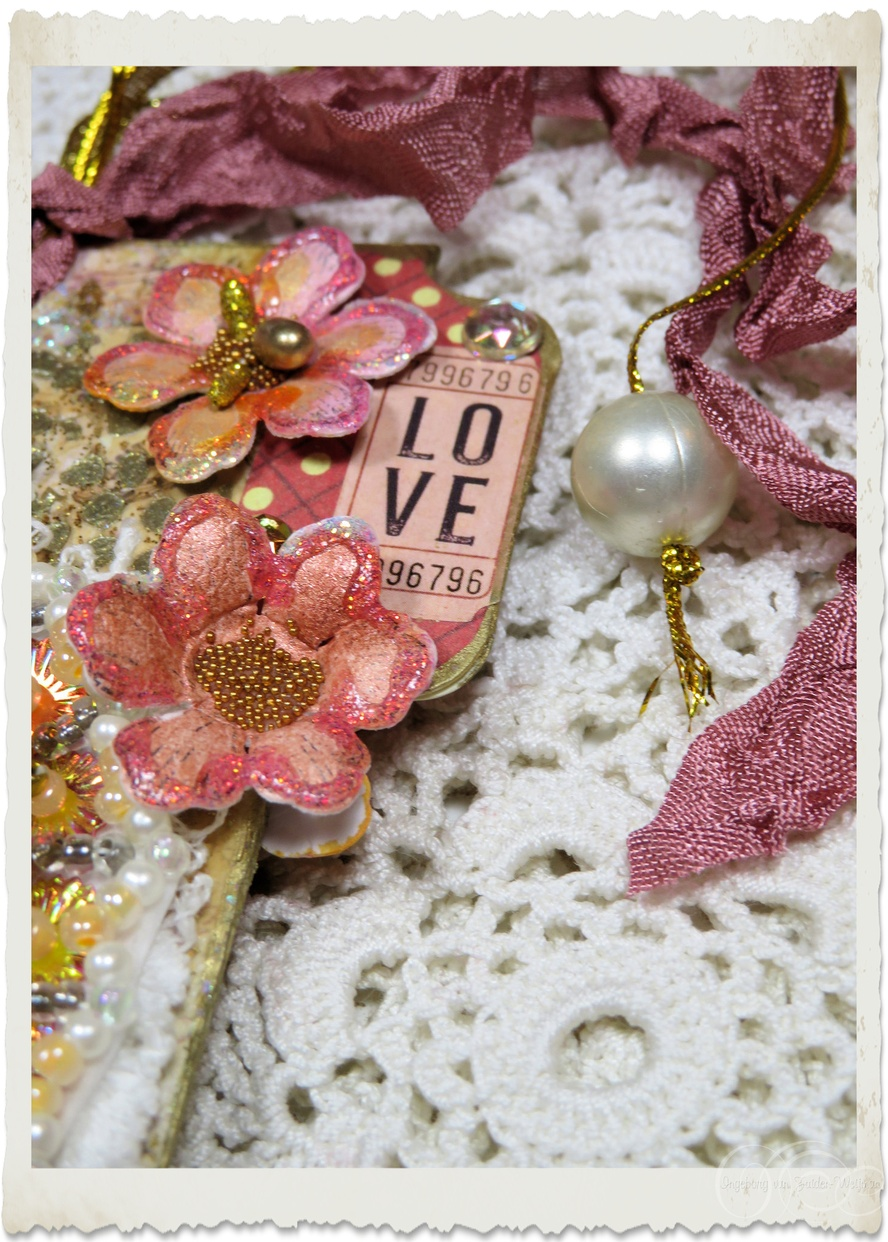 Details of handmade peach pink paper flowers and love ticket