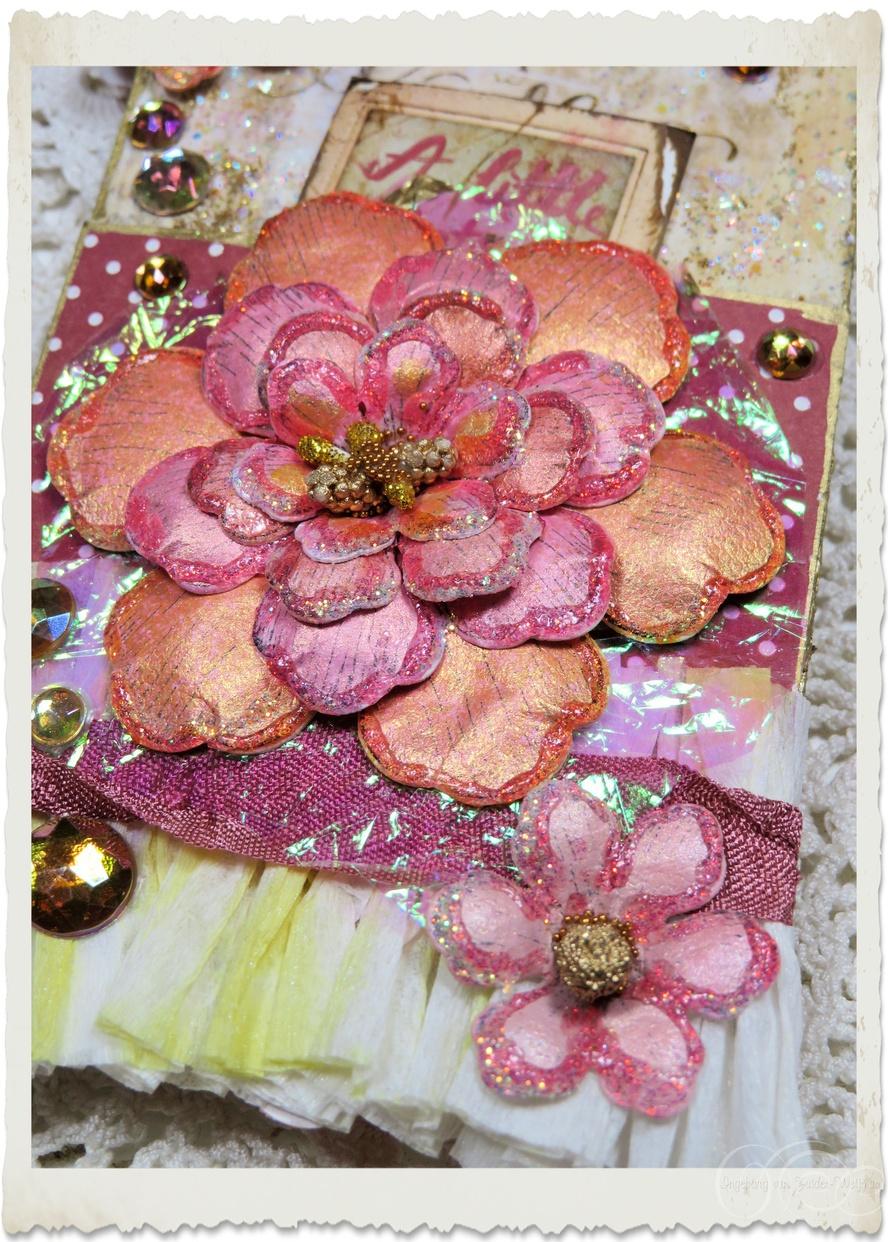 Details of handmade peach pink paper flowers with glitter by Ingeborg van Zuiden