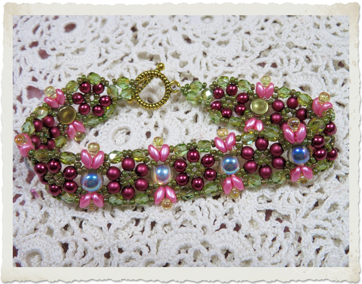 Pink red green beadweaving bracelet with AB iridescent 2-hole cabochon beads and Czech crystals