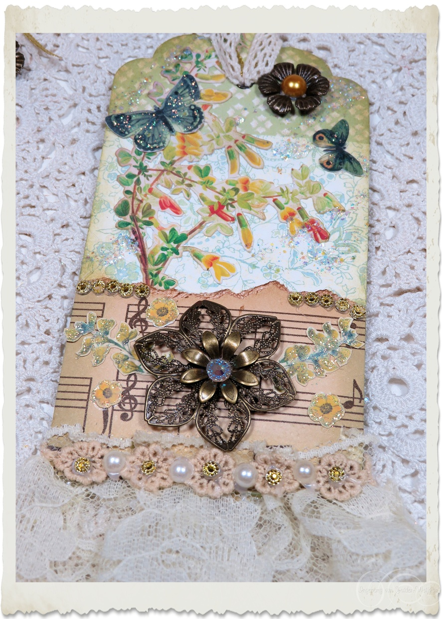 Backside of handmade mixed media pocket tag. The pocket insert is behind the music paper