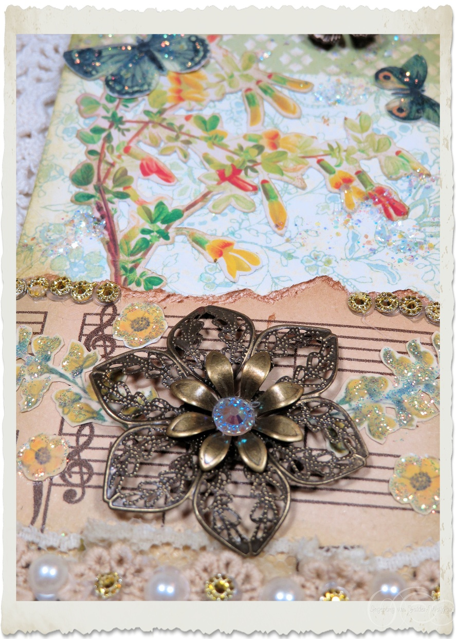 Pretty bronze coloured flower with bling heart