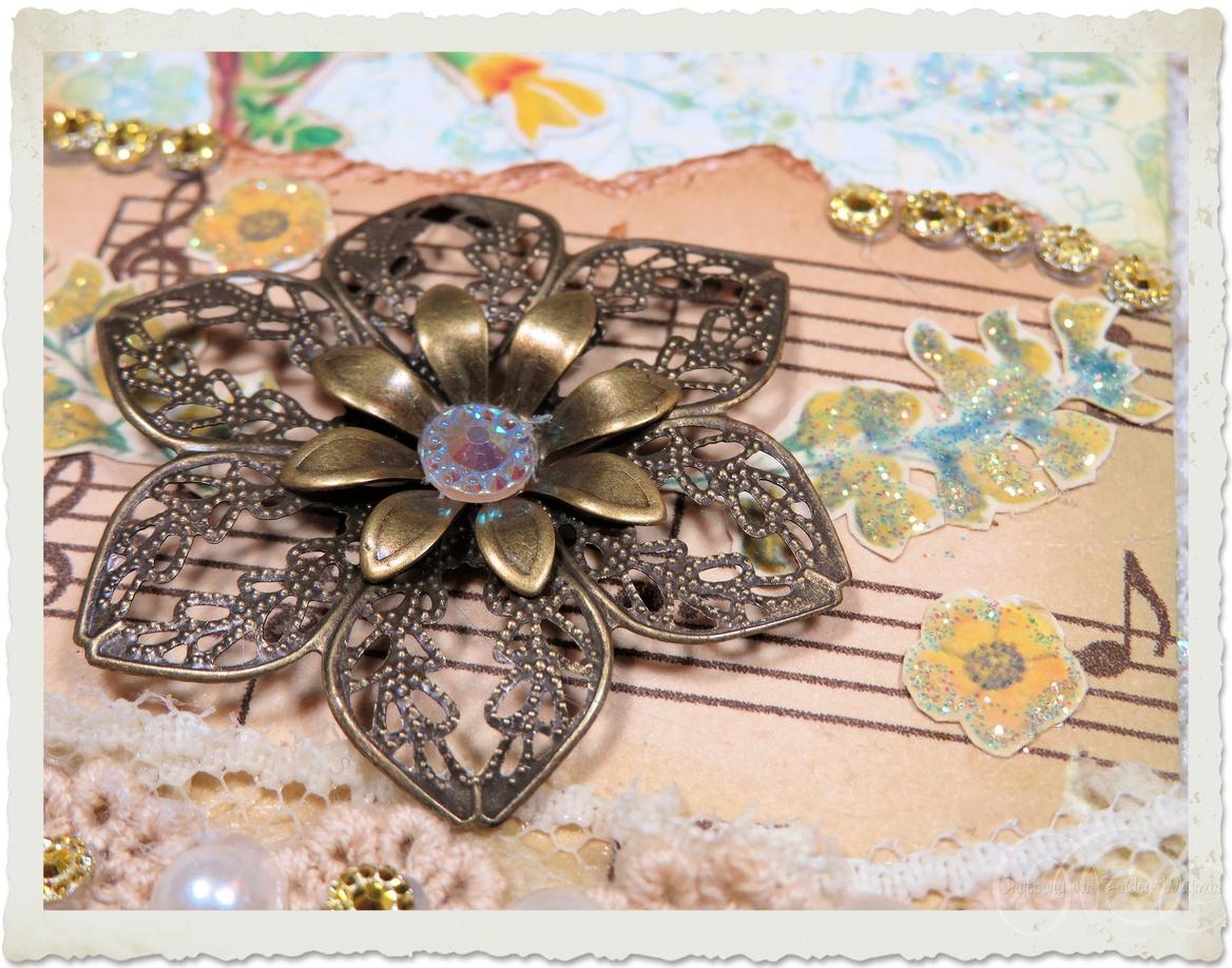 Bronze metal filligree flower